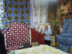 Musa Kayra admiring the quilts