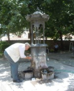 Old man drinking from the city fountain in Tokat