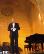 Fikri Toros, chairman of the Kyrenia Chamber Choir, opening the evening