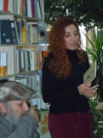 Aliye reads from her book with Yaşar Ersoy listening