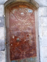 Old copper door in Bey Quarter