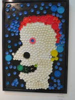 A portrait with bottle tops