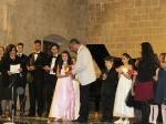 Fikri Toros congratulates the young musicians