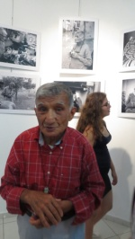 Mehmet Şik in front of the photos honouring him