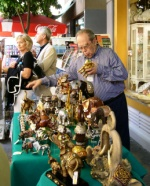 Shop owner selects one of his elephants to make a present to the Mayor of Nicosia
