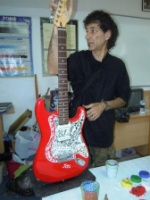 Senol Özdevrim in his art class with glass mosaic on guitar
